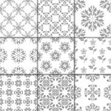 Gray and white floral ornaments. Collection of seamless patterns Royalty Free Stock Photo