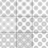 Gray and white floral ornaments. Collection of seamless patterns. Gray and white floral ornaments. Collection of neutral seamless patterns for paper, textile Royalty Free Stock Images