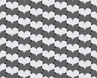 Gray and white hearts. Seamless ornament. Gray and white hearts. Oblique stripes Royalty Free Stock Image