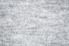 Gray and white knitted wool sweater texture Royalty Free Stock Photos