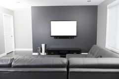 Gray and white living room with tv stand and sofa Stock Images