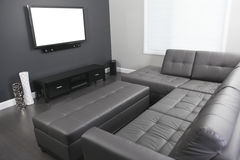 Gray and white living room with tv stand and sofa Stock Photos