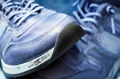 Gray and White Low Top Laced Up Running Shoes Stock Photography