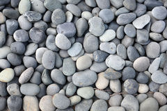 Gray and white round stones. Royalty Free Stock Photography