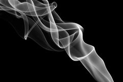 Gray and white smoke on the black background. Smooth waves of smoke Royalty Free Stock Photo