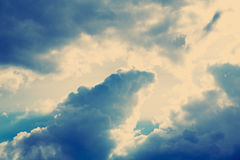Gray and white storm, rainy clouds over blue sky. Stock Images