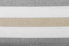 Gray white striped textile as background texture. Closeup of grey gray white horizontal striped fabric textile as background texture or pattern. Macro Royalty Free Stock Photography