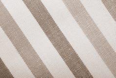 Gray white striped textile background texture. Closeup of grey gray white striped fabric textile as background texture or pattern. Macro Stock Photo