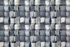 Gray wicker fabric canvas for upholstery furniture. Indoor closeup royalty free stock photo