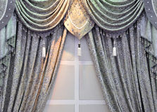 Gray window curtain. A window curtain design with edging and tassel in gray color, in symmetrical placement Royalty Free Stock Photos