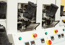 Gray winterized boots in manufacturing process Royalty Free Stock Photos