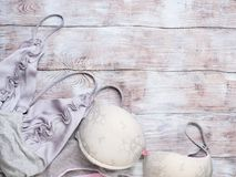 Gray woman lingerie set on wooden background Stock Images