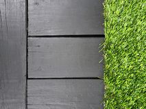 Gray wood background with green grass. Great for a landscape business Stock Images
