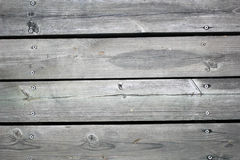 Gray Wood Plank. Texture with Some Nails Embedded in It Stock Photos