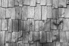 Gray wood shingle tiles roof texture. Closeup surface detail of gray (grey) wood shingle tiles roof texture - use for pattern background in architecture design Stock Photo