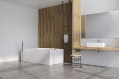 Gray and wooden bathroom, tub side. Gray and wooden bathroom interior with a wooden shelf, a sink standing on it, a horizontal mirror, a tub and a small chair in vector illustration