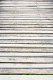Gray wooden boardwalk weathered with rough textured Stock Photography