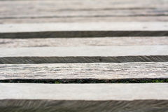 Gray wooden boardwalk weathered with rough textured Stock Images