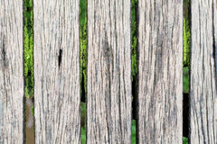 Gray wooden boardwalk weathered with rough textured Stock Photo