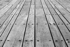 Gray wooden floor made of boards with bolts Royalty Free Stock Image
