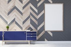 Gray and wooden living room, poster, closet. Modern living room interior with gray and wooden walls, a concrete floor, and a blue set of drawers with a framed Stock Photos