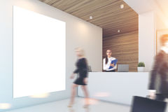 Gray and wooden office, reception, people Stock Image