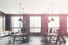 Gray and wooden open space office side view, man stock images