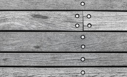 Gray wooden wall made of boards with bolts Stock Photo