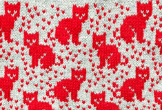Gray wool background. With picture of red cats Royalty Free Stock Images