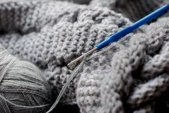 Gray yarn and hook Stock Photos