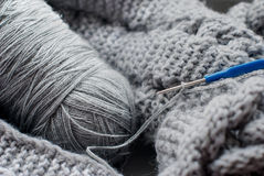 Gray yarn and hook Stock Photography