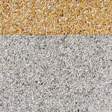 Gray and yellow color gravel floor Stock Image