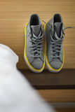 Gray and yellow sneakers Stock Photography