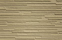 Gray yellow white beige rough surface with deep relief and shadows, horizontal lines. A gray yellow white beige rough surface with deep relief and shadows stock image