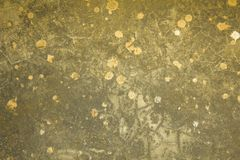 A gray yellow white old dirty damaged concrete wall with cracks stained paint. rough surface texture. Gray yellow white old dirty damaged concrete wall with stock image