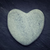 Gray zen heart shaped rock on a tile Stock Images