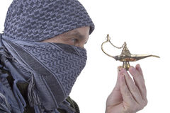 Graying Arab man with lamp Royalty Free Stock Photography