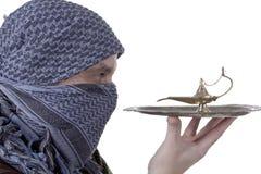 Graying Arab man with lamp Stock Images