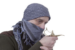 Graying Arab man with lamp Stock Image
