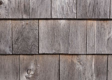 Graying cedar exterior wall shingles. Rows of graying red cedar on an exterior wall weathered by exposure Royalty Free Stock Photo
