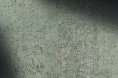 Grayish Green Weathered and Distressed Texture Lit Diagonally Royalty Free Stock Images