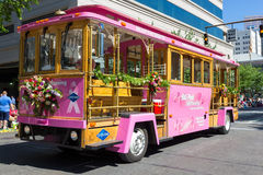 Grayline Big Pink Sightseeing Trolley Stock Photos