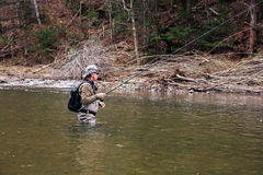 Grayling fishing on the river in autumn Royalty Free Stock Image