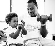 Grayscale of black family exercising Royalty Free Stock Image