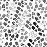 Grayscale human shoes footprint various sole seamless pattern eps10 Royalty Free Stock Image