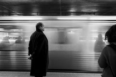 Grayscale of Man Near Train on Train Station Royalty Free Stock Photos