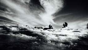 Grayscale Photo of 2 Person Swimming on Ocean Royalty Free Stock Image