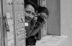 Grayscale Photo of 2 Woman on Window Pane Stock Image
