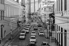 Grayscale Photo of Assorted Cars at the Middle of High Rise Buildings Stock Image
