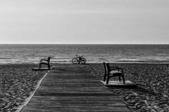 Grayscale Photo of Bicycle Beside Seashore Royalty Free Stock Photography